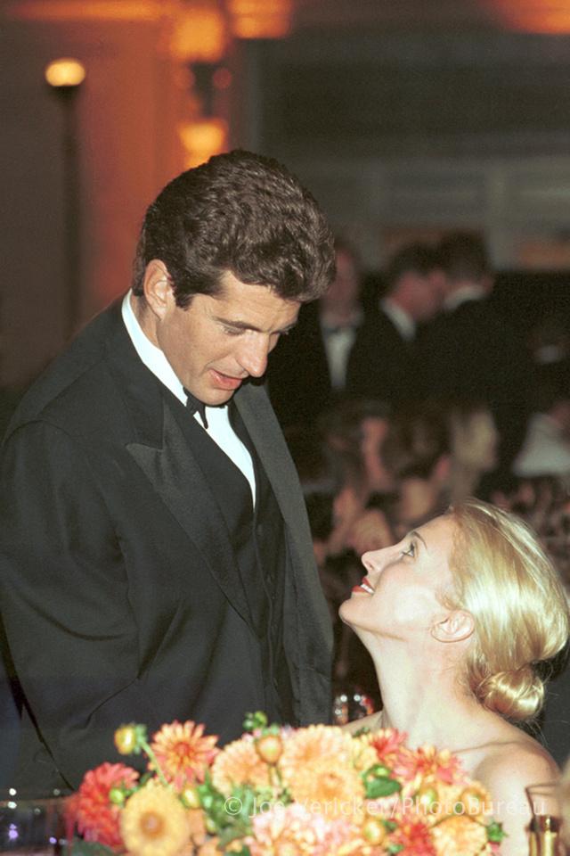 JFK JR. and his bride, Carolyn Bessette Kennedy share a tender moment. © Joe Vericker PhotoBureau